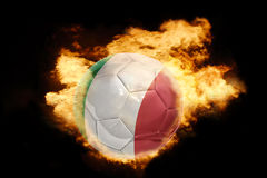 Football ball with the flag of italy on fire. Football ball with the national flag of italy on fire on a black background Royalty Free Stock Photo