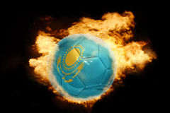 Football ball with the flag of kazakhstan on fire. Football ball with the national flag of kazakhstan on fire on a black background Stock Photo