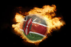 Football ball with the flag of kenya on fire. Football ball with the national flag of kenya on fire on a black background royalty free stock photos