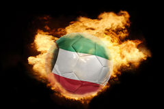 Football ball with the flag of kuwait on fire Stock Photo