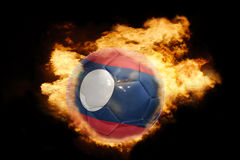 Football ball with the flag of laos on fire. Football ball with the national flag of laos on fire on a black background Royalty Free Stock Photography