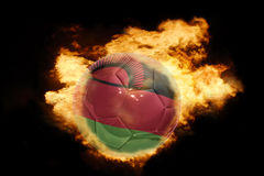 Football ball with the flag of malawi on fire Royalty Free Stock Photography