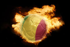 Football ball with the flag of mali on fire. Football ball with the national flag of mali on fire on a black background Stock Images
