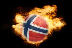 Football ball with the flag of norway on fire. Football ball with the national flag of norway on fire on a black background Royalty Free Stock Photography