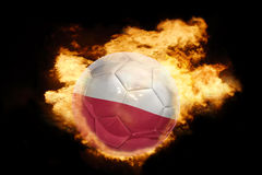 Football ball with the flag of poland on fire. Football ball with the national flag of poland on fire on a black background Royalty Free Stock Photos
