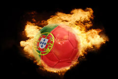 Football ball with the flag of portugal on fire. Football ball with the national flag of portugal on fire on a black background Stock Photos