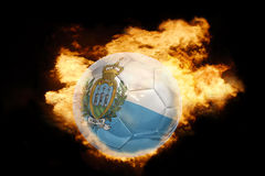 Football ball with the flag of san marino on fire. Football ball with the national flag of san marino on fire on a black background Royalty Free Stock Image