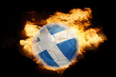 Football ball with the flag of scotland on fire. Football ball with the national flag of scotland on fire on a black background Royalty Free Stock Photos