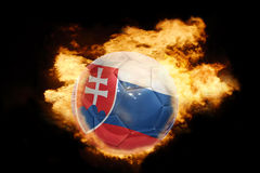 Football ball with the flag of slovakia on fire. Football ball with the national flag of slovakia on fire on a black background Royalty Free Stock Photography