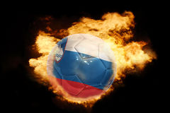 Football ball with the flag of slovenia on fire. Football ball with the national flag of slovenia on fire on a black background Stock Photography