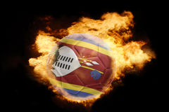 Football ball with the flag of swaziland on fire Royalty Free Stock Photos