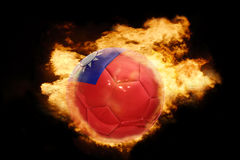 Football ball with the flag of taiwan on fire Royalty Free Stock Photos
