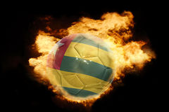 Football ball with the flag of togo on fire Stock Photos