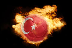 Football ball with the flag of turkey on fire. Football ball with the national flag of turkey on fire on a black background Royalty Free Stock Photos