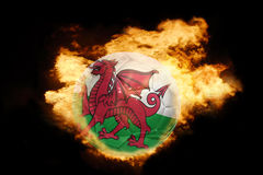 Football ball with the flag of wales on fire Royalty Free Stock Images