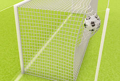 Football ball flies into the net gate Stock Photos