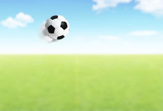 Football ball flying over field. Competitive team sport, open play space, green grass stadium outdoor, action slow motion, concept background of games and stock photos