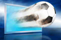 Football ball go out through blue screen. Football ball go out through the blue screen. Allegory with popular game and reportage about it Stock Photo
