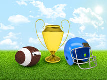 Football ball, gold cup and helmet in the of field Stock Photos