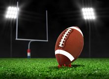 Football Ball On Grass under Spotlights Stock Photos