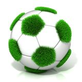 Football ball with grassy field instead black Royalty Free Stock Photography