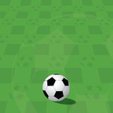 Football ball on green field Royalty Free Stock Photo