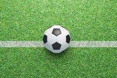 Football ball on green grass, render 3d illustration Stock Photos