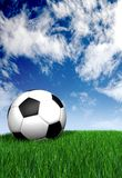Football ball on green grass - soccer Royalty Free Stock Photos