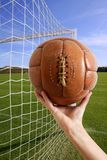 Football ball in hand net soccer goal Royalty Free Stock Images