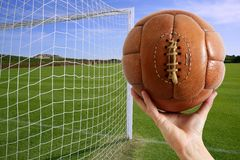 Football ball in hand net soccer goal Stock Photos