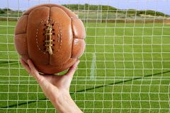 Football ball in hand net soccer goal Royalty Free Stock Image