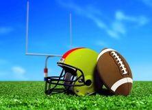 Football Ball and Helmet On Grass Stock Images