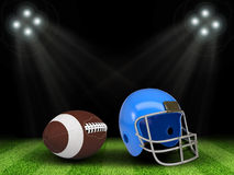 Football ball and helmet in the middle of field. Night sport arena illuminated by spotlights. Football ball and helmet in the middle of field. Sports background Stock Photos