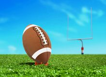 Football Ball on Kicking Tee with Goal Post Stock Photos