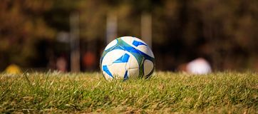 Soccer ball in the middle of a field ready to be kicked. Blurred nature background. Football ball in the middle of a field ready to be kicked. Blurred nature Stock Images