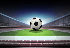 Football ball in midfield of magic stadium own design Royalty Free Stock Images