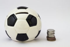Football ball moneybox and money Royalty Free Stock Photography