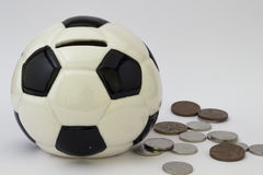 Football ball moneybox and money Royalty Free Stock Images