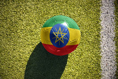 Football ball with the national flag of ethiopia lies on the field Royalty Free Stock Image