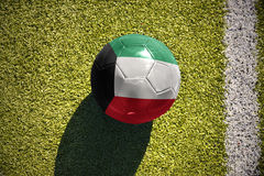 Football ball with the national flag of kuwait lies on the field Royalty Free Stock Photos