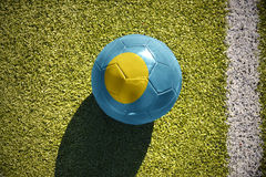 Football ball with the national flag of Palau lies on the field Royalty Free Stock Photography