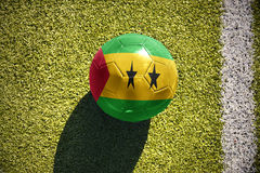 Football ball with the national flag of sao tome and principe lies on the field. Football ball with the national flag of sao tome and principe lies on the green Stock Photography