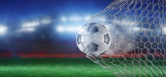 Football ball in the net of a goal - 3d rendering Stock Photo