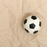 Football ball on old paper Royalty Free Stock Photography