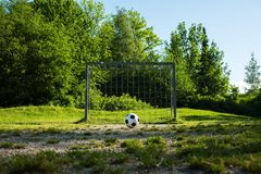 Football, ball on penalty spot, football ground for the youth royalty free stock photos