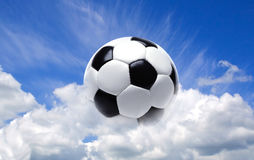 Football ball in the sky. Football ball in the clouds sky Stock Image