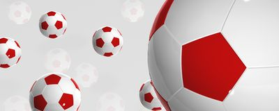 Football balls. Red and white bouncing football balls with reflection Stock Image