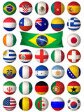Football balls. 3D football balls mapped with the flags of different World Nations Stock Images