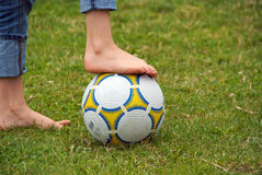 Football, with bare child feet Royalty Free Stock Photos