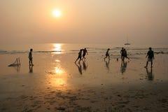 Football on the beach. Boys play football on the beach thailand Stock Photos